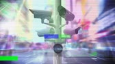 erro : Digital animation of surveillance cameras moving and colorful static flickering in the foreground and background of a road