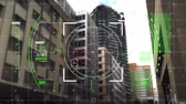 spielraum : Digital animation of viewfinder with green squares moving in the screen with a background of buildings
