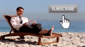 descontraído : Digital composite of Caucasian businessman lying on a bench at the beach while typing on his tablet. Beside him is a subscribe button with a hand icon pointing towards it for social media.