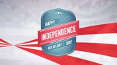 saudações : Digital animation of Happy Independence Day and 4th of July greeting in digital badge zooming out in the screen with a background of red stripes and stars