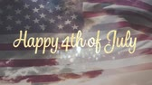 gloire : Digital animation of gold Happy 4th of July greeting appearing in the screen with American flag waving while background shows the sky with clouds during sunset. Vidéos Libres De Droits