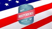 odznak : Digital animation of Happy Independence Day, 4th of July text in badge zooming out in the screen while background shows American flag waving Dostupné videozáznamy