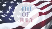 написанный : Digital animation of 4th of July text in white circle zooming out in the screen while an American flag waves in the background