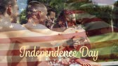 jednota : Digital composite of a group of diverse friends celebrating in a pool over drinks while the American flag waves behind a gold Independence Day text with bokeh. Dostupné videozáznamy