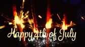 yazılı : Digital animation of a gold Happy 4th of July text with bokeh lights while lighted sparkles flicker in the dark background. Stok Video