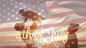 4分の1 : Digital composite of silhouette of a family at the beach, the father lifts up the baby during sunset while the American flag waves behind a gold 4th of July text in the background