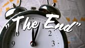 çalar saat : Animation of the words the end are displayed on alarm clock and documents in the background