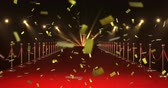 beroemdheid : Digital animation of gold confetti falling in the screen while background shows a red carpet with barriers and lights Stockvideo