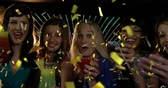 flauta : Digital composite of a diverse group of female friends celebrating over drinks in a club while gold confetti falls in the screen Vídeos