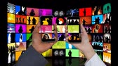 melodia : Digital animation of a screen field with music videos. On the foreground are two hands each holding a smartphone with music on the screens
