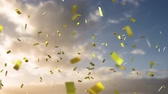 золотой : Digital composite of a bright cloudy sky with falling digital gold confetti