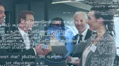 introducing : Digital composite of a businessman and a businesswoman shaking hands. Beside them are their colleagues. In the middle of the foreground is a rotating globe with binary codes Stock Footage