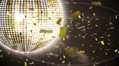 patro : Digital animation of a rotating disco ball with glowing lights. On the foreground are falling confetti Dostupné videozáznamy