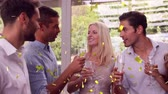 cerveja : Digital composite of a group of friends talking and drinking wine. On the foreground are confetti falling down