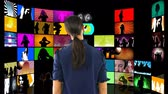 ekran : Digital composite of a woman with back turned watching videos on LCD screens Wideo