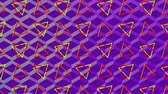 rendelés : Animation of turning yellow and red triangles and a purple background with a diamond shaped reflective mesh changing from blue to purple Stock mozgókép