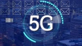 tarama : Animation of 5g displayed in a rotating circle with a envelope icons and cityscape in the background