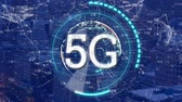 Animation of 5g displayed in a rotating circle with a cityscape in the background