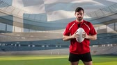 rugby : Animation of a Caucasian male rugby player playing with a ball and looking to camera with blowing Greek flag and stadium in the background
