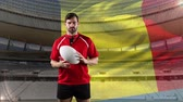 belga : Animation of a Caucasian male rugby player playing with a ball and looking to camera with blowing Belgian flag and stadium in the background Vídeos