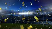 zafer : Animation of golden confetti falling down in front of sports stadium Stok Video