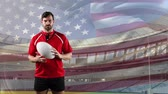 rugby : Animation of a Caucasian male rugby player playing with a ball and looking to camera with blowing American flag and stadium in the background