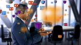 scolaresca : Animation of colourful cubes rising while an African American businessman is using a tablet in the background