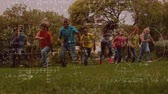 ожидание : Animation of multi-ethnic schoolchildren running in the park with mathematical formulae in the foreground Стоковые видеозаписи