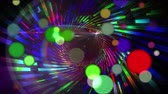traslucido : Animation of coloured spots of defocused twinkling light passing in front of a colourful spiral of light rotating on a black background