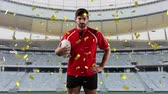 rugby : Animation of a Caucasian male rugby player playing with a ball and looking to camera with golden confetti falling and a sports stadium in the background