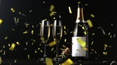 flauta : Animation of a close up of a cork shooting up from a champagne bottle with two glasses and golden confetti falling on a black background