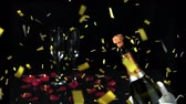 flauta : Animation of a close up of a cork shooting up from a champagne bottle with two glasses and rose petals and golden confetti falling on a black background