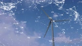 nature resources : Animation of a turning wind turbine against a blue sky with network connections in white floating around it Stock Footage