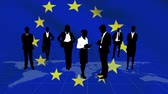 leden : Animation of a blowing EU flag with silhouettes of business people standing on a world map and networking in the background
