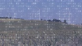 windenergie : Animation of turning wind turbines on a rural horizon against a blue sky with changing binary coding in white filling the foreground