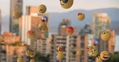 out of focus : Animation of a group of emoji icons flying from right to left over an out of focus cityscape 4k