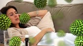 抗生物質 : Animation of green 3d viruses with an ill Caucasian woman lying on a sofa and sneezing the background 動画素材
