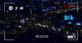 zamanlama : Animation of night traffic in fast motion and cityscape, seen on a screen of a digital camera in record mode with icons and timer 4k