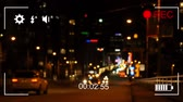 cronometragem : Animation of night traffic, seen on a screen of a digital camera in record mode with icons and timer