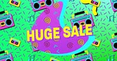 zapisovač : Animation of the words Huge Sale in yellow letters with a purple crescent and brightly coloured tape recorder and tape icons, abstract shapes on a blue background 4k Dostupné videozáznamy