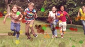 spotlight : Animation of coloured spots of defocused twinkling light passing in front of young children running to camera across a garden Stock Footage