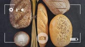 resim çerçevesi : Animation of a close up of loaves of bread, salt and a bunch of wheat on grey background, seen on a screen of a smartphone in picture mode with icons in the foreground Stok Video