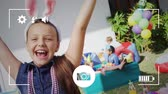 freundlichkeit : Animation of a portrait of a pre teen Caucasian girl wearing bunny ears and smiling to camera at a birthday party with a group of children in the background, seen on a screen of a smartphone in picture mode with icons in the foreground