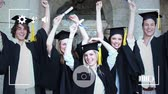 freundlichkeit : Animation of a group of Caucasian students graduating and celebrating with arms in the air, seen on a screen of a smartphone in picture mode with icons in the foreground