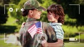 родитель : Animation of a young Caucasian female soldier embracing her young son holding an American flag, seen on a screen of a smartphone in picture mode with icons in the foreground