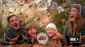 mami : Animation of a portrait of a young Caucasian man and woman with their young son and daughter throwing leaves in the air in a park in autumn, seen on a screen of a smartphone in picture mode with icons in the foreground Archivo de Video