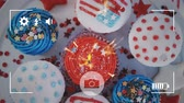 indépendance : Animation of a close up of cupcakes decorated with American flags and fireworks, seen on a screen of a smartphone in picture mode with icons in the foreground