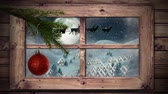 oslava : Animation of winter scenery seen through window, with Santa Claus in sleigh being pulled by reindeers, snowfall, moon and Christmas tree with a red bauble