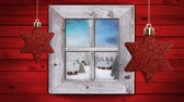 色 : Animation of winter scenery seen through window, with snowfall, houses and red star Christmas decorations 動画素材