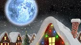 色 : Animation of winter scenery at night with Santa Claus in sleigh being pulled by reindeers, snowfall, moon and houses 動画素材